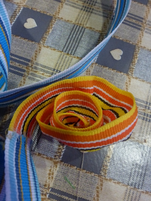 Ribbon gathered by running stitch.