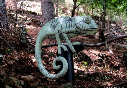 Ceramic chameleon in a forest