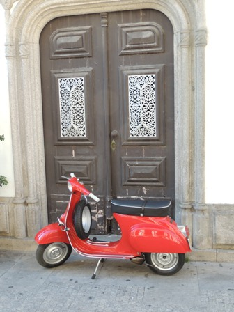 Fancy Portuguese door with old fashioned scooter