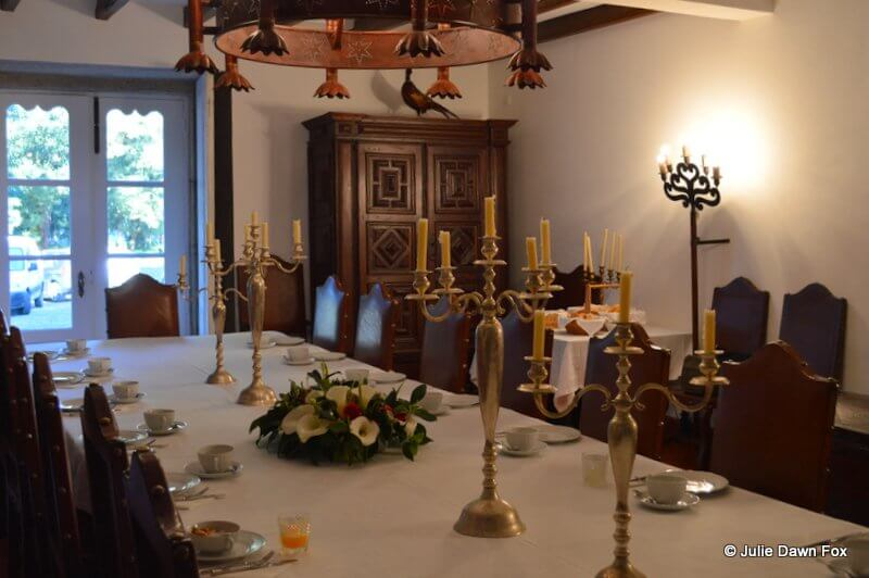 The guest breakfast room at Paço dos Calheiros is also rather grand with its leather studded chairs and chandelier.