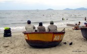 Lifeguards in a round Vietnamese fishing boat, Hoi An