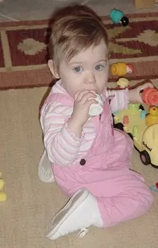 Toddler Catherine, decked out in pink