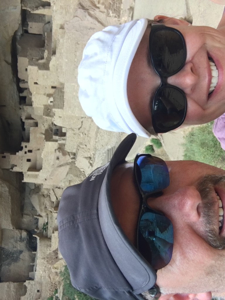 Bobby and Julie Marburger standing in front of an ancient Indian run at Mesa Verde National Park