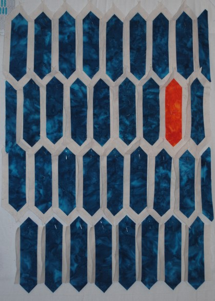 Turquoise and orange oblong geometric tiles quilt