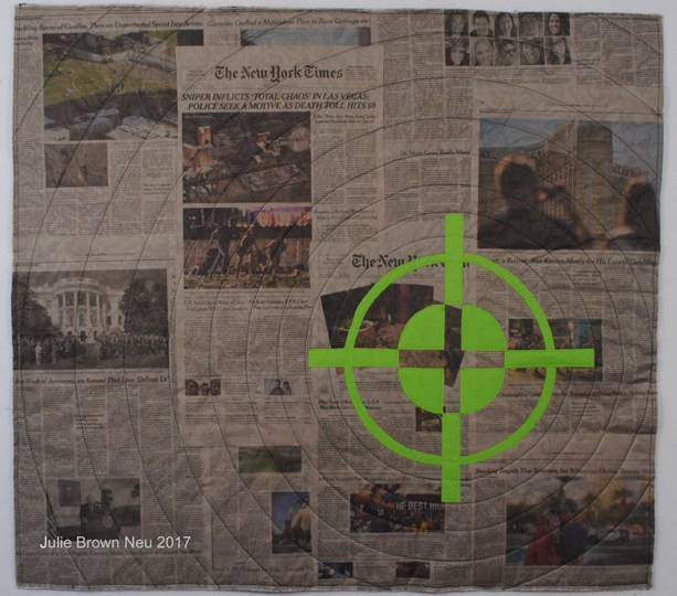 art quilt of newspaper headlines from Las Vegas Shooting, overlaid with green gun sight image