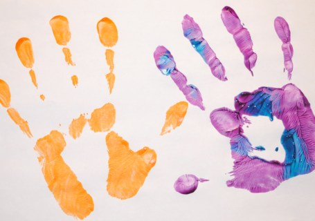 purple and orange painted hand prints