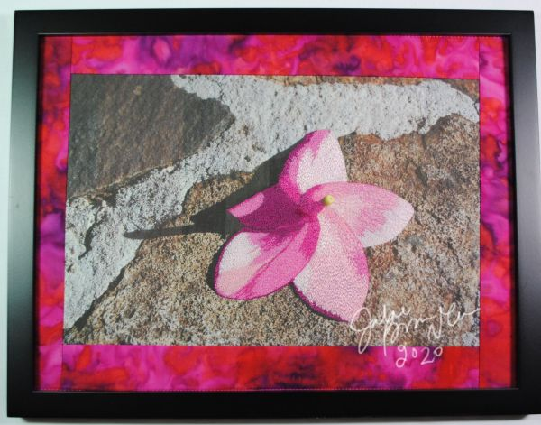 pink flower on stone thread painting