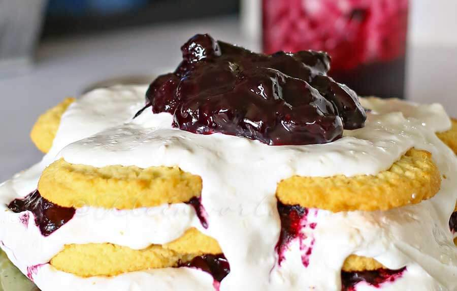 Blueberry Ice Box Cake ~ Easy, No Bake Dessert Recipe Stacked with Coconut Cookies, Creamy Topping and Blueberry Pie Filling!