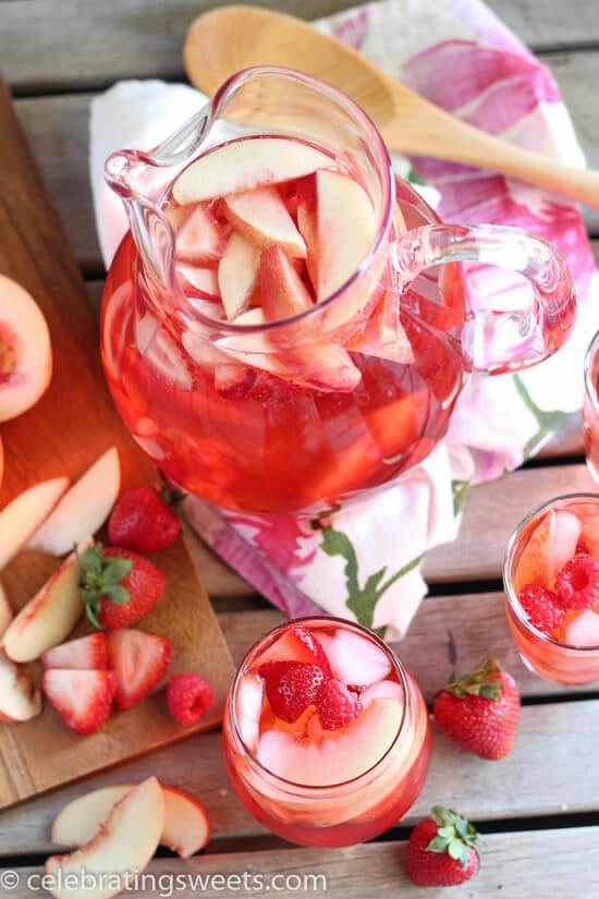 Peach Rosé Sangria - Rosé, peach juice, peach liqueur, and fresh fruit combine in this beautiful sangria.