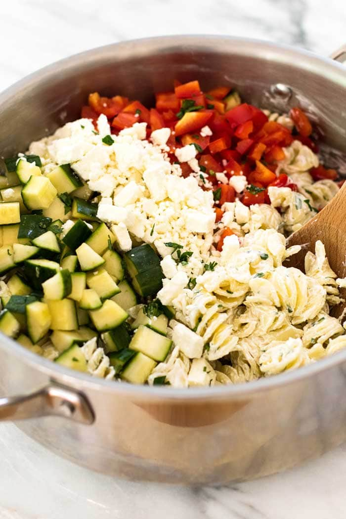 Greek Pasta Salad ~ Loaded with Bell Pepper, Cucumber, Pasta and Topped with a Creamy Yogurt Dressing! It's Perfect for Summer!