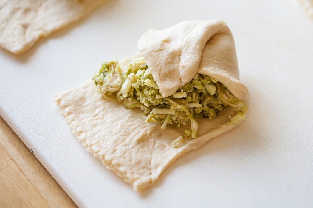 Pesto Chicken Pillows are chicken, pesto and cheese wrapped up in a soft croissant. Only 4 Ingredients and 30 Minutes until Dinner is Served!