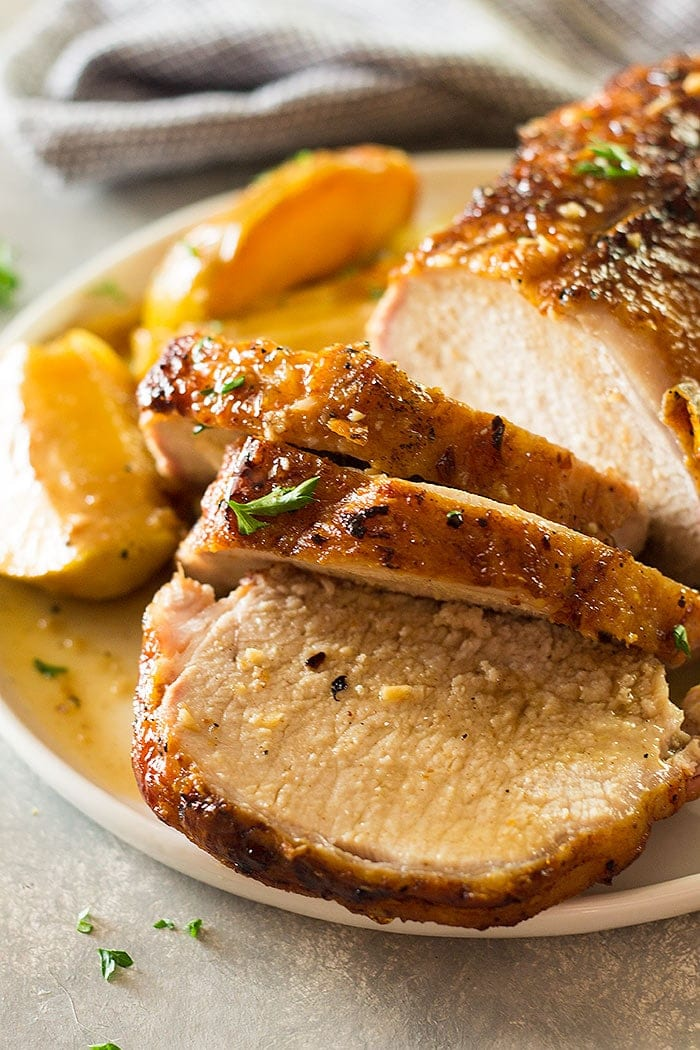 This Maple Pork Loin with Apples and Onions is an easy meal that tastes and feels more like a holiday meal! It's tender, juicy and full of flavor!