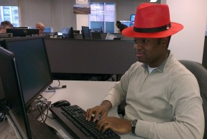 Wearing the red hat in the office
