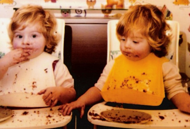This is my sister and I at about 18 months - she is stealing my cake crumbs!