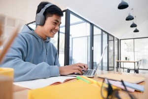 young-asian-student-man-wearing-headset-and-looking-laptop-display-for-learning-online-course-from_t20_0xZGQ9