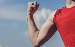 man-raising-his-right-arm