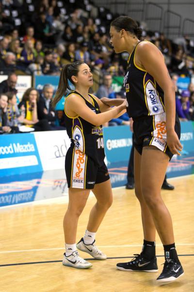 Monique Conti (Left)