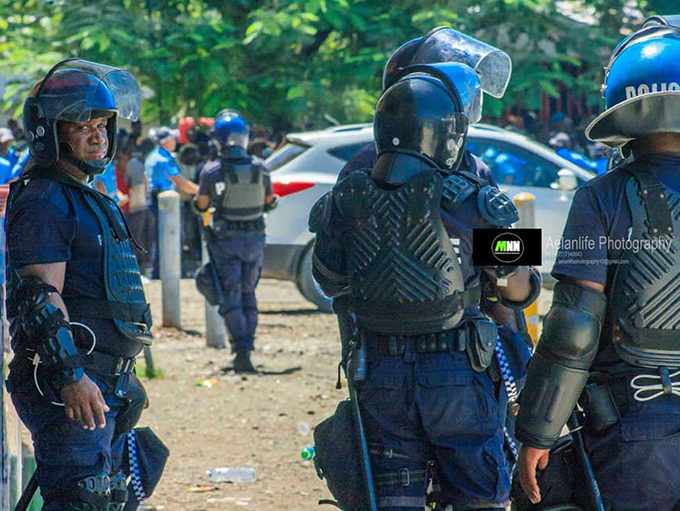 Solomon Islands police in riot gear during yesterday's post-election disturbances in Honiara.
