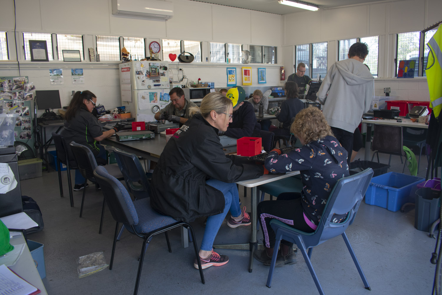 Volunteers concentrate on deconstructing disused electronic goods at eWaste Connection.