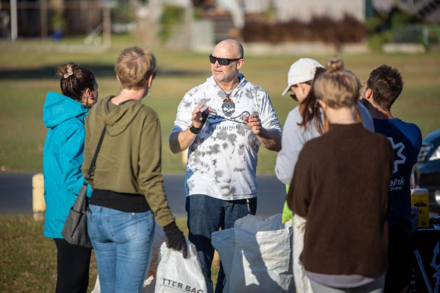Sea Shepherds Stuart Donald briefs a group of volunteers ahead of the Nudgee Beach clean-up