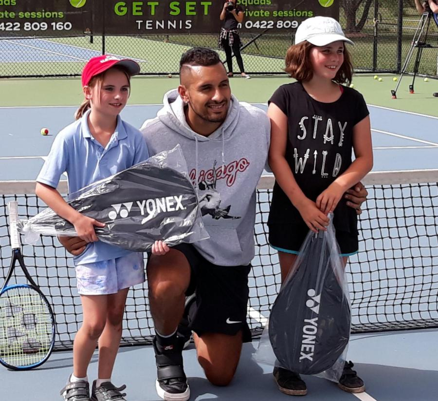 Nick+Kyrgios+is+happy+among+the+kids+at+an+open+day+for+his+charity.+