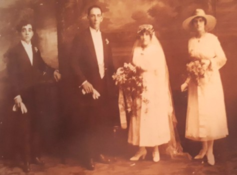 John Fleming's family pose for a wedding photograph, Lismore NSW (1919). (L-R) Gordon Fleming, Jim and Ethel Harder and Rita Fleming. Photo: supplied by the Gill Family.