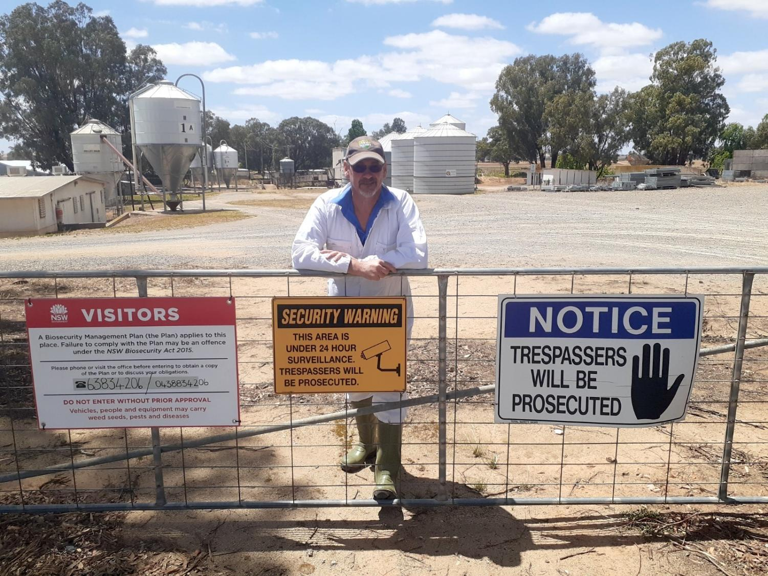 Pig Farmer Ean Pollard stands behind his gate on his property outside Young, Central West NSW. Photo: supplied