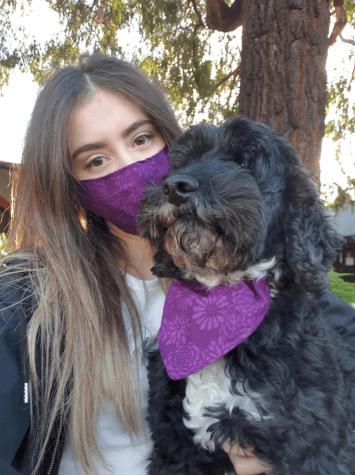 Angi Frentiu and her dog Radar wear Angi