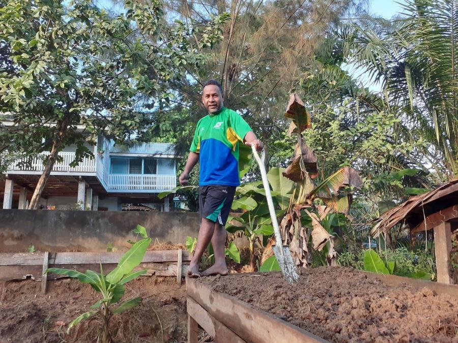 A farmer in the Solomon Islands prepares his plot for new crops.