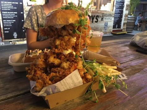 If you need to feed a crowd, or maybe just your very empty stomach, make sure you swing by The Rusty Crab. This incredible burger defies expectations, and it will certainly get a few hungry looks from the people you walk past.