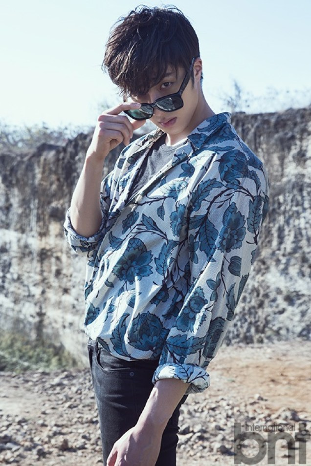 2014 10:11 Jung Il-woo in Bali for BNT International Part 3: Cliffy Goodness with Logo. Cr.BNT International 2
