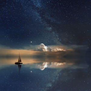 mindfulness for better sleep. night sky with stars and a boat on a calm sea.