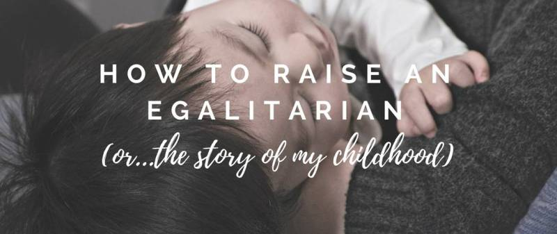 girl in mother's arms - how to raise an egalitarian
