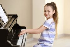 Small girl playing piano