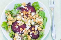 Mixed Green Salad with Beets, Feta, and Walnuts with Thyme-Roasted Parsnips and Onions