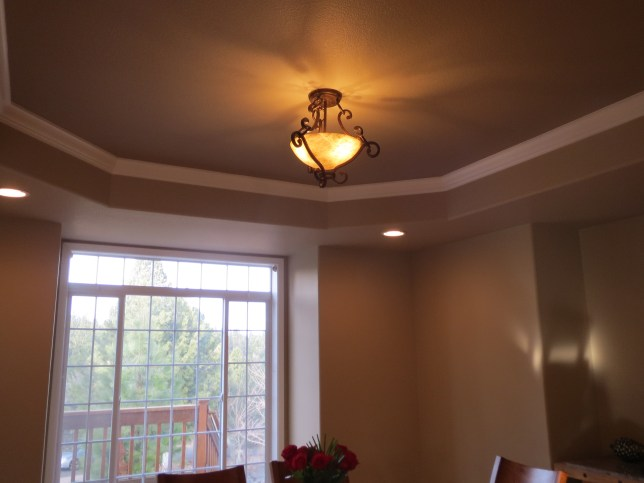 Tray ceiling with darker color for extra drama.