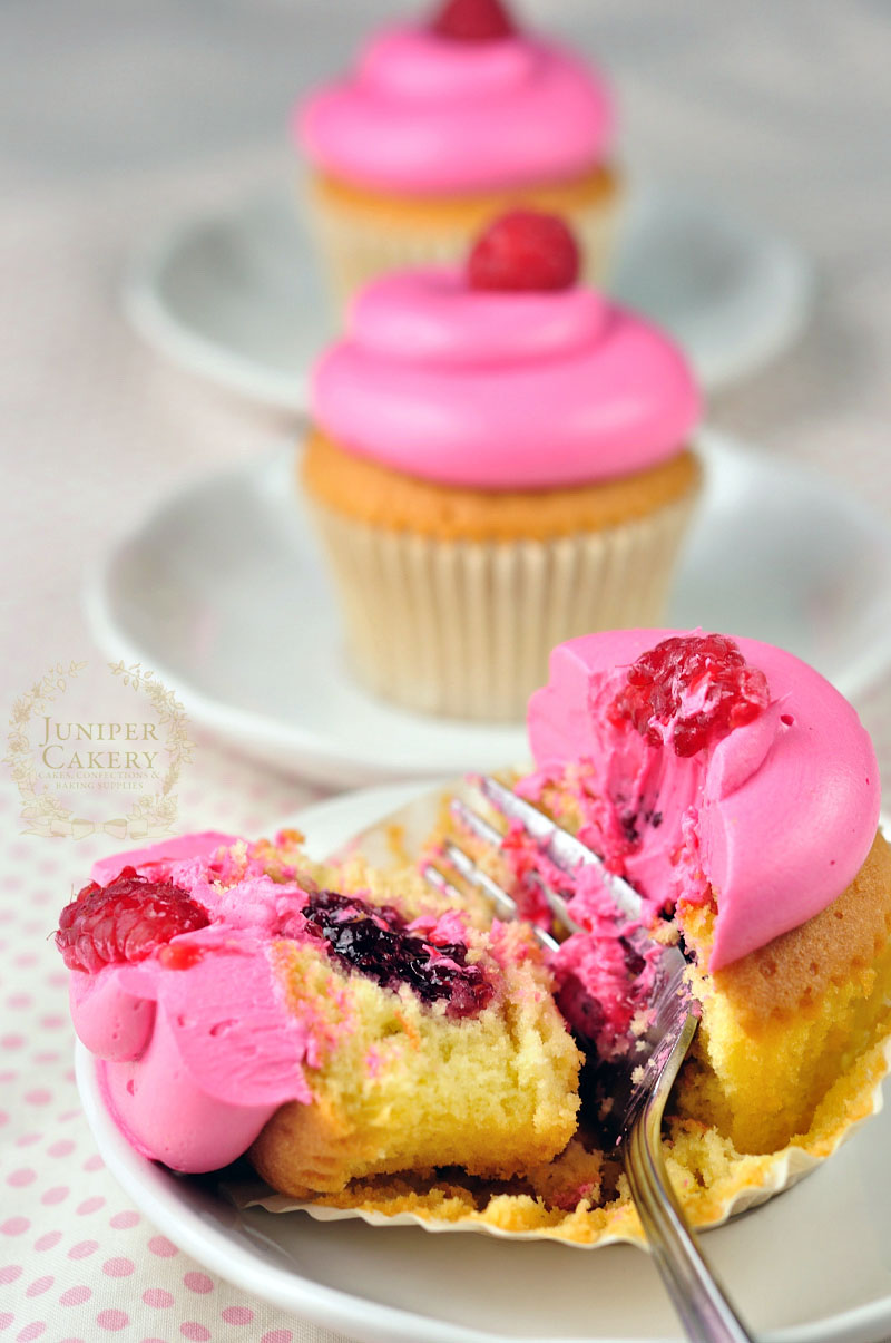 Raspberry cupcakes in a row by Juniper Cakery