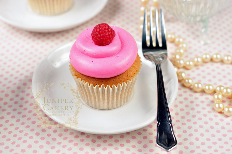 Raspberry jam filled cupcake by Juniper Cakery
