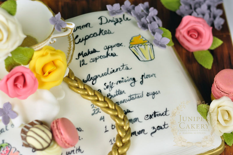 Cute recipe book cake by Juniper Cakery