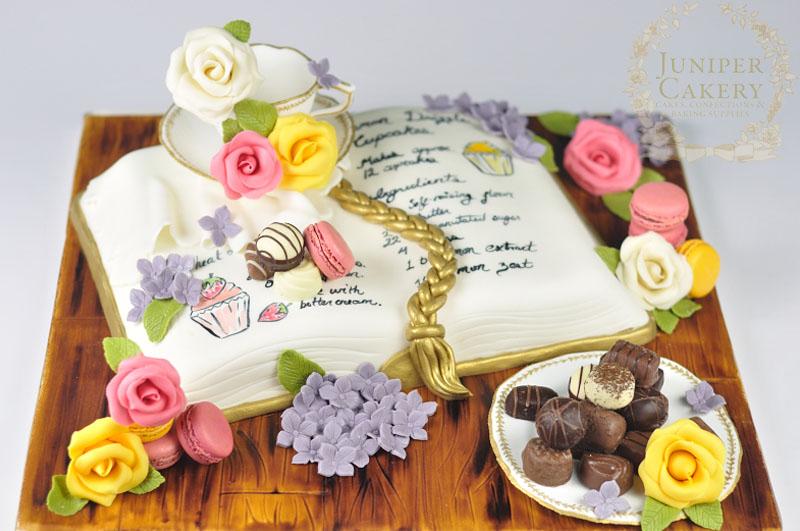 Tea, macarons and recipe book cake by Juniper Cakery