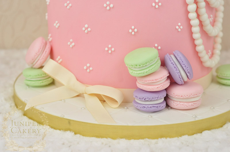 Tea and macarons themed cake with gum paste rabbit in teacup by Juniper Cakery