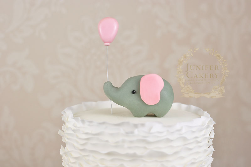 Ruffled baby shower cake with gum paste elephant by Juniper Cakery