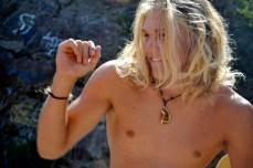 Steven Schmitz undoes his hair before putting on his kayaking gear.