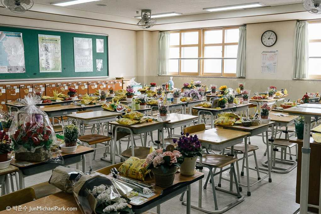 Time stands still at classrooms once occupied by the Sewol student victims. Flowers, treats and mementos are laid on the writing desks of the victims. Empty desks belong to survivors. Out of 325 students onboard, only 75 escaped the capsizing ferry and no one else was rescued.