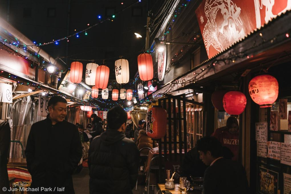KAGOSHIMA, JAPAN - February 4, 2016: Kagomma Furusato Yataimura is a mock village of food stalls and small restaurants. Its quaint alleyways with colorful lanterns provide a glimpse into authentic Japanese dining experience.