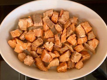 Salmon lines the casserole dish