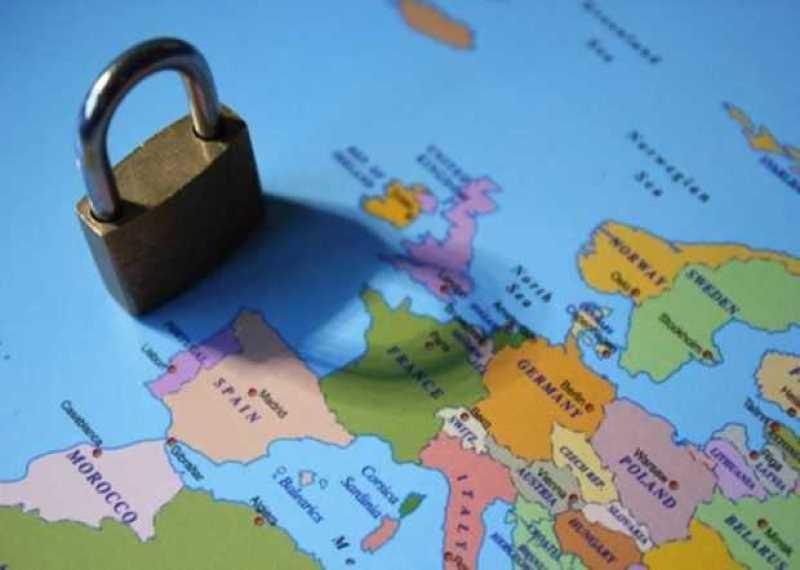 Lockdown coronavirus covid-19 virus concept padlock lock shadow across Europe including Spain,  Italy,  UK,  France,  germany,  greece,  poland,  ukraine Morocco Romania Bulgaria and rest,Image: 539287047, License: Royalty-free, Restrictions: , Model Release: no