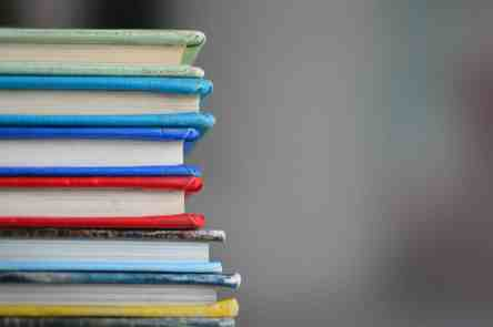 Stack of books to represent storing memorized facts in long term memory, memorization tools