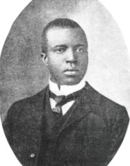 Black and white image of an African American man in a nice suit, Scott Joplin.