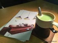 Hot Matcha Latte next to menu; Uchi